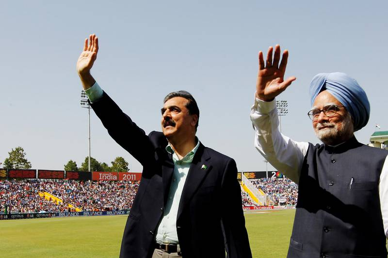 MOHALI, INDIA - MARCH 30:  Prime Minister Syed Yusuf Raza Gilani of Pakistan and Prime Minister Manmohan Singh of India wave to spectators prior to the start of the 2011 ICC World Cup second Semi-Final between India and Pakistan at Punjab Cricket Association (PCA) Stadium on March 30, 2011 in Mohali, India.  (Photo by Daniel Berehulak-Pool/Getty Images)