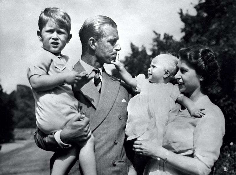 Undated picture showing the Royal British couple, Britain's Queen Elizabeth II, and her husband Britain's Prince Philip, Duke of Edinburgh, with their two children, Charles, Prince of Wales (L) and Princess Anne (R). (Photo by - / AFP)