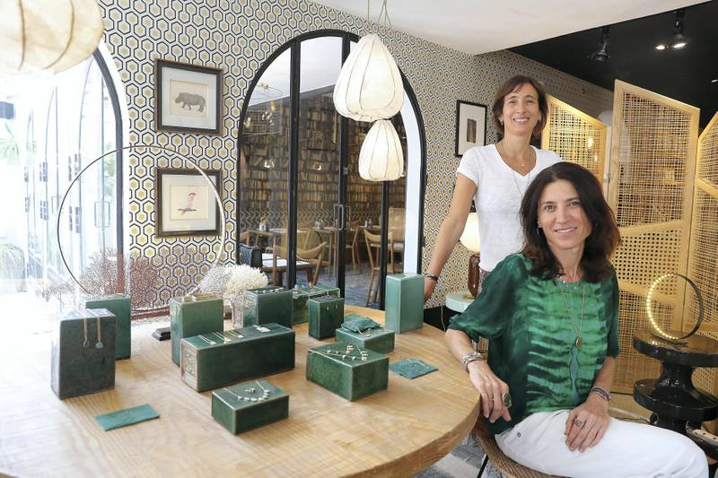 DUBAI , UNITED ARAB EMIRATES , SEP 19  ��� 2017 : - Emma Sawko , founder ( left in white ) and Mathilde Danglade , jewellery designer ( right in green ) with the new collection of jewellery which is on display at the Comptoir 102 on Jumeirah Beach Road in Dubai. ( Pawan Singh / The National ) Story by Hafsa Lodi
