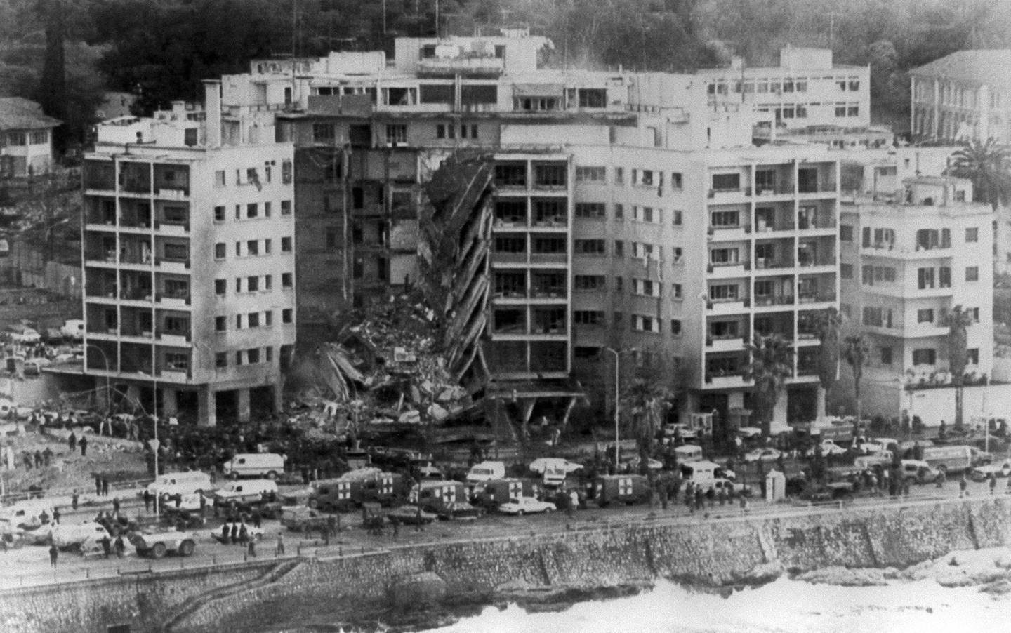 Aerial view of the United States embassy in Beirut, 18 April 1983, after a bomb destroyed part of the building. The whole front center section of the building collapsed from the blast. (Photo by US NAVY / AFP)