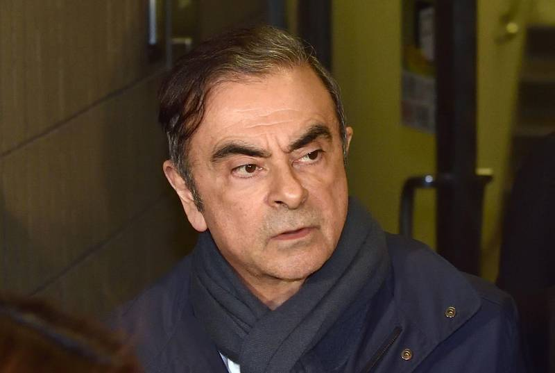 (FILES) This file photo taken on April 3, 2019 shows former Nissan Chairman Carlos Ghosn leaving the office of his lawyer Junichiro Hironaka in Tokyo. Former Nissan chief Carlos, who was on bail in Tokyo awaiting trial on financial misconduct charges, has arrived in Beirut, Lebanese official and security sources said on December 30, 2019. / AFP / Kazuhiro NOGI
