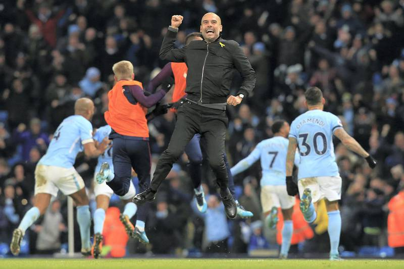 Manchester City's Spanish manager Pep Guardiola celebrates after Manchester City's English midfielder Raheem Sterling scores his team's second goal during the English Premier League football match between Manchester City and Southampton at the Etihad Stadium in Manchester, north west England, on November 29, 2017. - Manchester City won the match 2-1. (Photo by Lindsey PARNABY / AFP) / RESTRICTED TO EDITORIAL USE. No use with unauthorized audio, video, data, fixture lists, club/league logos or 'live' services. Online in-match use limited to 75 images, no video emulation. No use in betting, games or single club/league/player publications. /