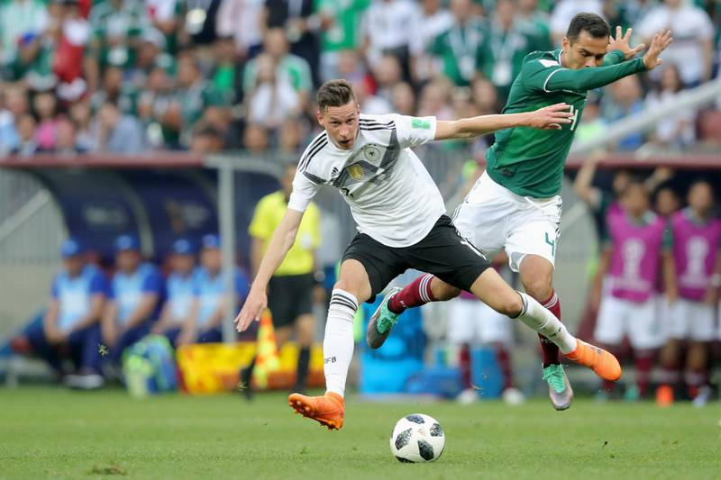 MOSCOW, RUSSIA - JUNE 17:  Julian Draxler of Germany battles for the ball with Rafael Marquez of Mexico during the 2018 FIFA World Cup Russia group F match between Germany and Mexico at Luzhniki Stadium on June 17, 2018 in Moscow, Russia.  (Photo by Alexander Hassenstein/Getty Images)