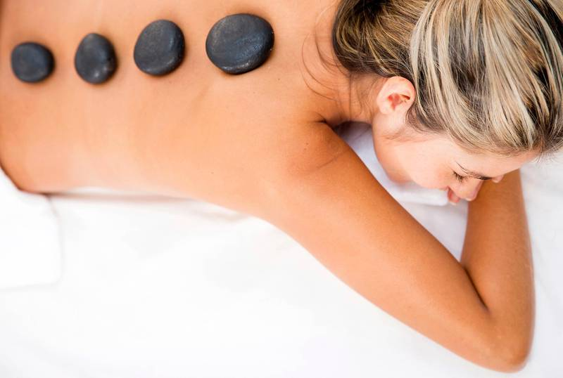 Woman getting a relaxing massage with hot stones. hot stone massage. CREDIT: iStock *** Local Caption ***  iStock_000023346473Medium.jpg