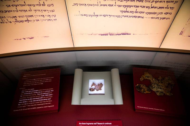 epa07112379 (FILE) A tiny fragment of what the Museum of the Bible thought was part of the Dead Sea Scrolls (bottom) turned out to be fake at the Museum of the Bible in Washington, DC, USA, 14 November 2017 (reissued 22 October 2018). The museum made the announcement on 22 October 2018. Privately funded by the conservative Christian family of Hobby Lobby founder David Green, the $500 million USD (428 million Euro) museum houses about 1,000 biblical artifacts. In 2017, Hobby Lobby agreed to pay the US government $3 million USD (2.5 million Euros) in fines for smuggling ancient artifacts out of Iraq and into the United States.  EPA/JIM LO SCALZO