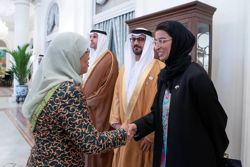 SINGAPORE, SINGAPORE - February 28, 2019: HE Halimah Yacob, President of Singapore (L), greets HE Noura Mohamed Al Kaabi, UAE Minister of Culture and Knowledge Development (R), prior to a meeting, at the Istana presidential palace.  ( Mohamed Al Hammadi / Ministry of Presidential Affairs ) —