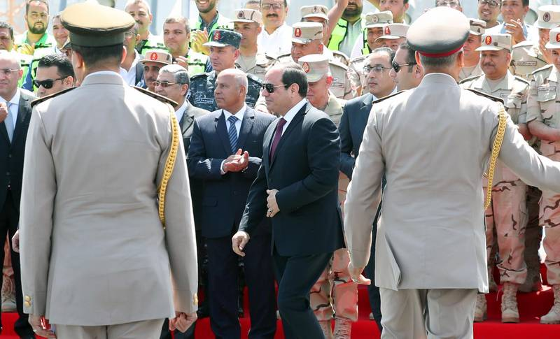 epa07572472 Egyptian President Abdel Fattah al-Sisi (C) attends the opening of the Rawd Al-Faraj bridge in Shobra district, Cairo, Egypt, 15 May l 2019. According to reports, Egypt requested to register the construction as the world's widest suspension bridge on the Guinness World Records. The length of the bridge is 720 meters and 14 meters above the level of the River Nile to facilitate the riverine movement. The suspension bridge is located within the third phase of the Rawd Al-Faraj axis, starts from Al-Khalafawi Square on the Corniche of the Nile in front of the Aghakhan Towers opposite the Nile on Al-Warraq Island passing through Bashteel area.  EPA/KHALED ELFIQI