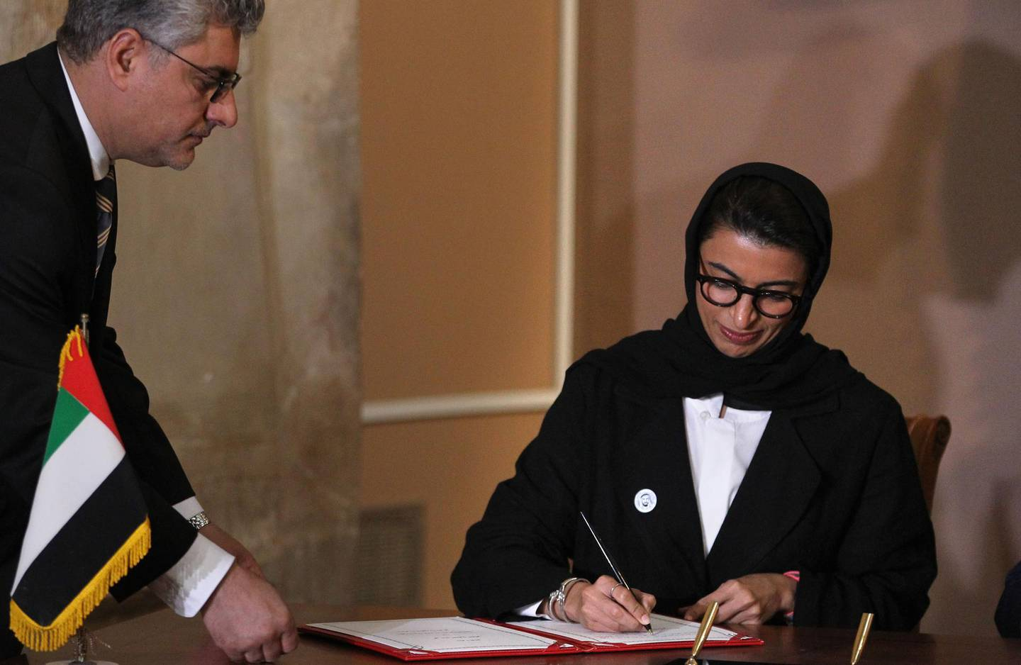 UAE Minister of Culture and Knowledge Development Noura al-Kaabi signs an agreement with Iraq's minister of culture and UNESCO on the reconstruction of Mosul's Al-Nuri mosque, on April 23, 2018 at the Iraqi National Museum in Baghdad.  The United Arab Emirates and Iraq signed an agreement to develop the rehabilitation of the Al-Nuri Mosque and its Al-Hadba minaret in the former embattled Iraqi northern city of Mosul, with financial support amounting to 50.4 million dollars. The Nuri mosque and its ancient leaning minaret, were blown up in June 217 by jihadists of the Islamic State group as Iraqi forces battled to retake the city.  / AFP PHOTO / AHMAD AL-RUBAYE