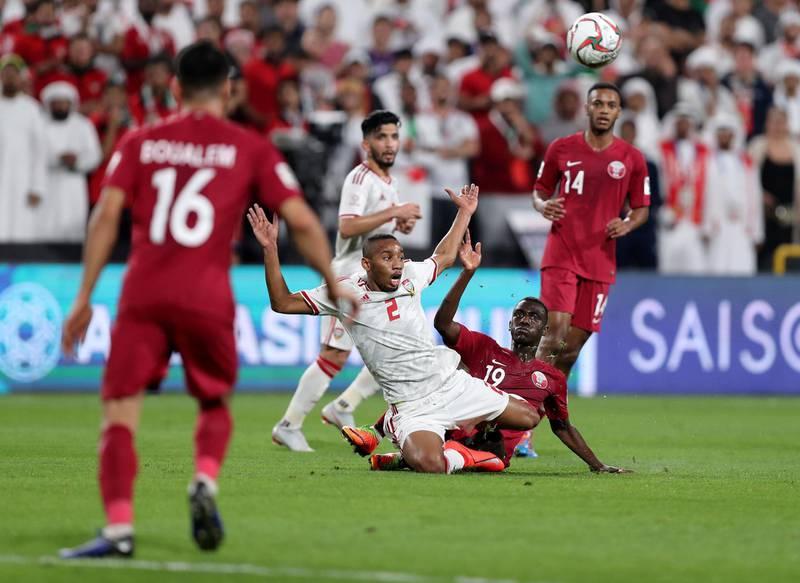 Abu Dhabi, United Arab Emirates - January 29, 2019: UAE's Ali Salmin battles with Qatar's Almoez Ali during the semi final between the UAE and Qatar in the Asian Cup 2019. Tuesday, January 29th, 2019 at Mohamed Bin Zayed Stadium Stadium, Abu Dhabi. Chris Whiteoak/The National