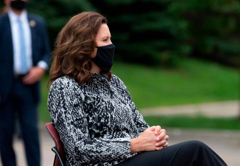 (FILES) In this file photo taken on September 09, 2020, Michigan Governor Gretchen Whitmer listens as Democratic presidential candidate Joe Biden (off camera) speaks at the United Auto Workers Union Headquarters in Warren, Michigan. Six men have been charged as part of a militia plot to kidnap Michigan Governor Gretchen Whitmer, who was repeatedly attacked by President Donald Trump this year for her tough coronavirus lockdown, according to court records released on on October 8, 2020. A sworn affadavit from an FBI agent detailed the outlines of the plot which was thwarted by law enforcement. / AFP / JIM WATSON