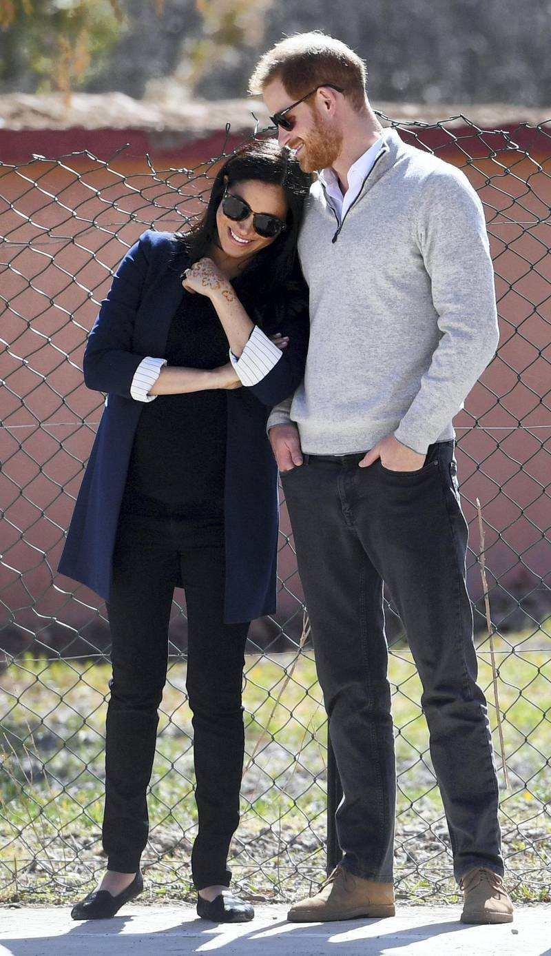ASNI, MOROCCO - FEBRUARY 24:   Meghan, Duchess of Sussex and Prince Harry, Duke of Sussex watch students play football during their visit to Lycée Qualifiant Grand Atlas, the local secondary school on February 24, 2019 in Asni, Morocco.  (Photo by Facundo Arrizabalaga - Pool/Getty Images)