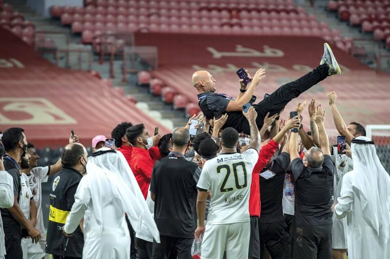 Arabian Gulf League final round: Al Jazira v Khorfakkan at Mohamed bin Zayed stadium.  The Jazira team celebrates their victory over Khorfakkan on May 11th, 2021. Victor Besa / The National.