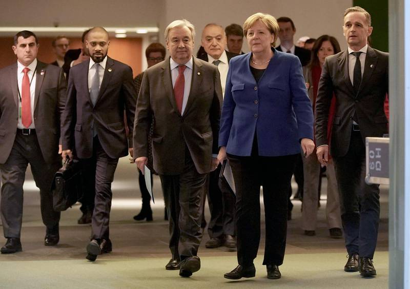 German Chancellor Angela Merkel, German Foreign Minister Heiko Maas (R) and Secretary-General of the United Nations (UN) Antonio Guterres leave after a press conference at the end of a Peace summit on Libya at the Chancellery in Berlin on January 19, 2020. Held under the auspices of the UN, the summit's main goal was to get foreign powers wielding influence in the region to stop interfering in the war -- be it through the supply of weapons, troops or financing. / AFP / POOL / Michael Kappeler