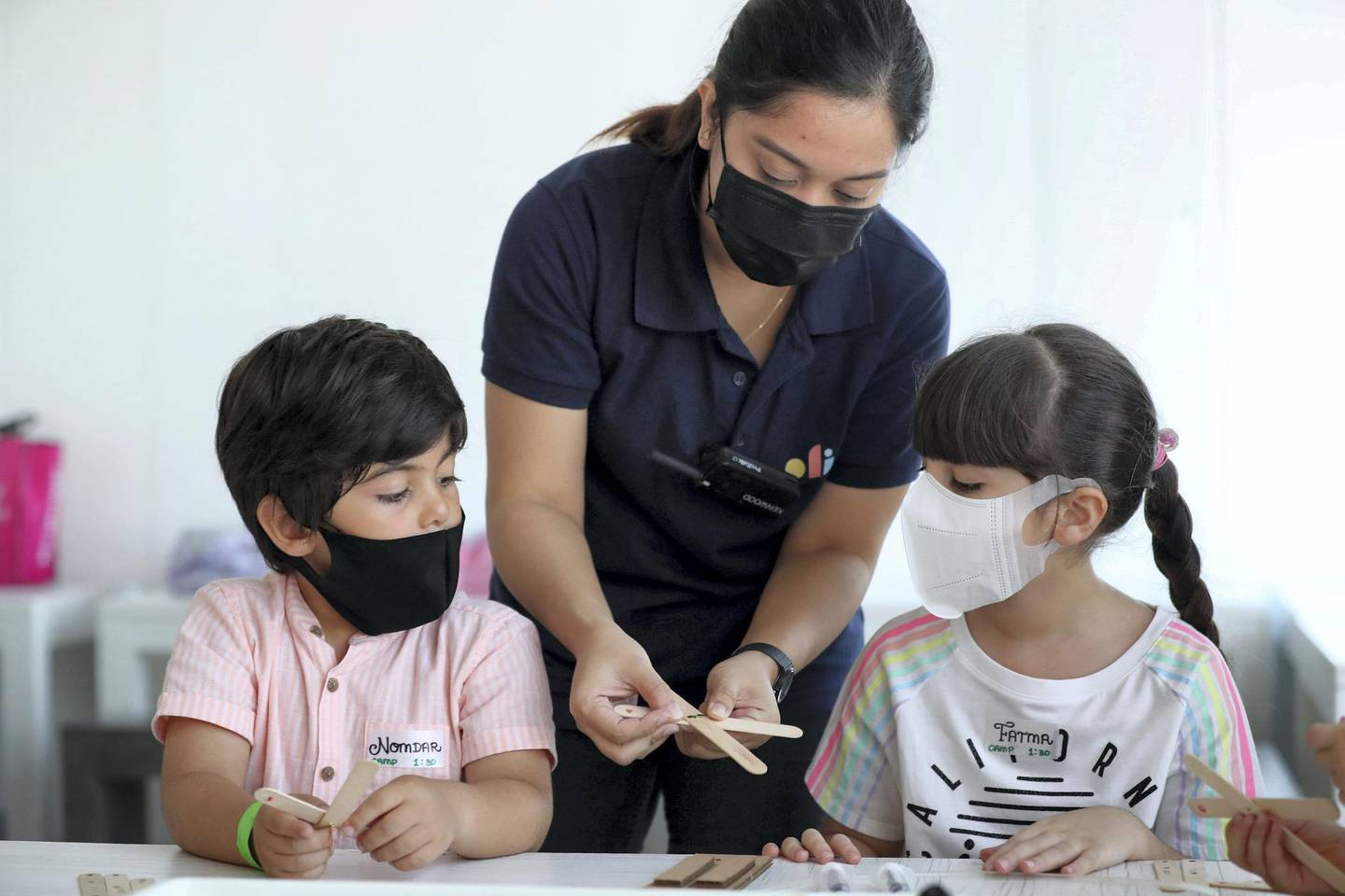 Dubai, United Arab Emirates - Reporter: N/A. Photo project. Children's summer activities. Nomdar and Fatma do mechanical engineering with instructor Sunshine at the OliOli summer camp. Summer activities for teenagers and children open up after school has finished with Covid-19/Coronavirus protection measures. Tuesday, July 14th, 2020. Dubai. Chris Whiteoak / The National