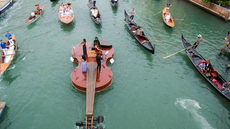 An image that illustrates this article Giant violin sails down Venice's Grand Canal