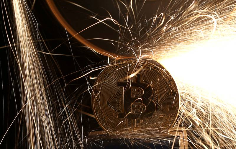 FILE PHOTO: Sparks glow from broken Bitcoin (virtual currency) coins in this illustration picture, December 8, 2017. REUTERS/Dado Ruvic/Illustration/File Photo