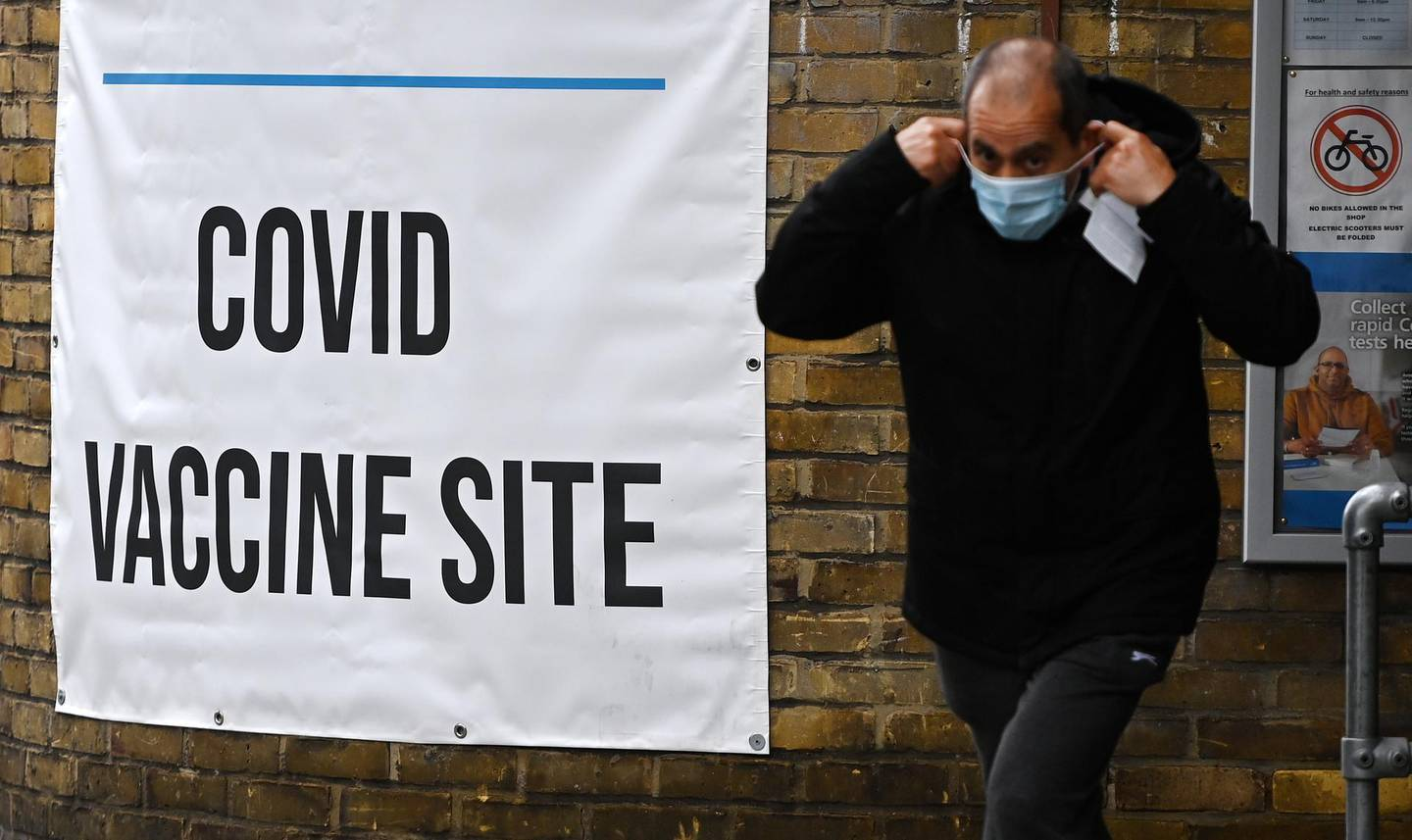epa09226468 A man exits a Covid vaccine centre in central London, Britain, 25 May 2021. The government is coming under pressure to answer questions over its apparent failure to notify local health chiefs of crucial Covid-19 travel advice.  EPA/ANDY RAIN