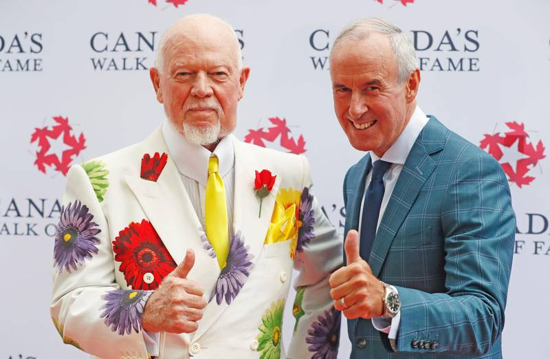 """FILE PHOTO: Storied Canadian hockey sportscasters Don Cherry (L) and Ron MacLean, hosts of """"Coach's Corner on Hockey Night in Canada"""", unveil their 2015 Canada's Walk of Fame star on King St in Toronto, Ontario Canada July 25, 2016.     REUTERS/Mark Blinch/File Photo"""