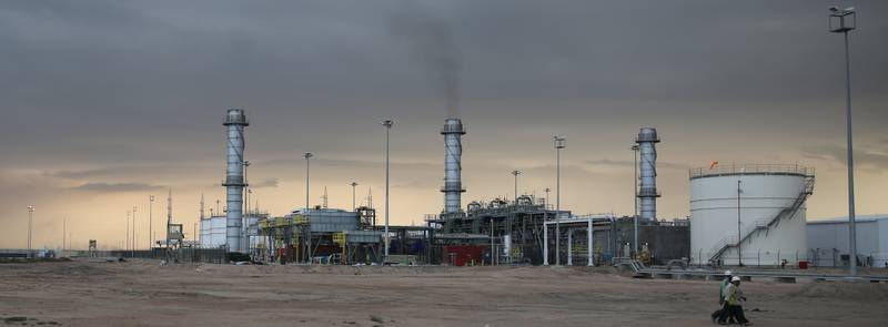 A view of West Qurna oilfield is seen in Basra, southeast of Baghdad, on March 11, 2014. Production from Iraq's giant West Qurna-2 oilfield will lift national output to 4 million barrels per day (bpd) by the end of the year, oil minister Abdul Kareem Luaibi said. Courtesy Lukoil