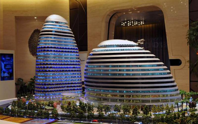 This picture shows a model of the Meiquan 22nd Century building in China's southwest Chongqing on January 3, 2012.  Already famed for fake designer bags and pirated DVDs, imitation in China may have reached new heights with a set of towers that strongly resemble ones designed by renowned architect Zaha Hadid. It could rank among the more flagrant ripoffs in a country already notorious for imitating foreign products without permission -- but the developer of the Chongqing project, Meiquan 22nd Century, has denied any copying.       CHINA OUT     AFP PHOTO