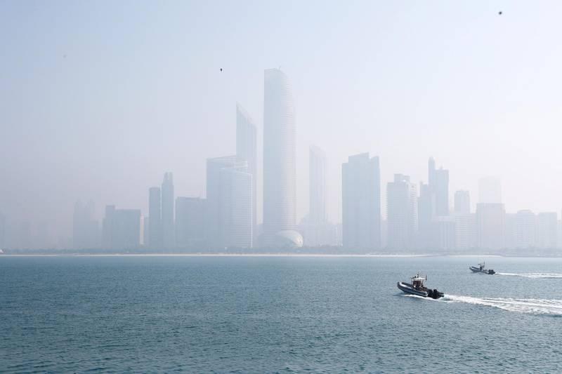 Abu Dhabi, U.A.E., February 8, 2018.  Fog at The Corniche UAE flag area.  View of Abu Dhabi high rise buildings from the UAE flag area.  Victor Besa / The NationalNational