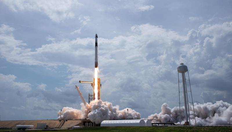 """This handout photo released by NASA shows a SpaceX Falcon 9 rocket carrying the company's Crew Dragon spacecraft launched from Launch Complex 39A on NASA's SpaceX Demo-2 mission to the International Space Station with NASA astronauts Robert Behnken and Douglas Hurley onboard on May 30, 2020, at NASA's Kennedy Space Center in Florida.  The Demo-2 mission is the first launch with astronauts of the SpaceX Crew Dragon spacecraft and Falcon 9 rocket to the International Space Station as part of the agency's Commercial Crew Program. The test flight serves as an end-to-end demonstration of SpaceX's crew transportation system. Behnken and Hurley launched at 3:22 p.m. EDT on Saturday, May 30, from Launch Complex 39A at the Kennedy Space Center. A new era of human spaceflight is set to begin as American astronauts once again launch on an American rocket from American soil to low-Earth orbit for the first time since the conclusion of the Space Shuttle Program in 2011. - RESTRICTED TO EDITORIAL USE - MANDATORY CREDIT """"AFP PHOTO / NASA / BILL INGALLS"""" - NO MARKETING - NO ADVERTISING CAMPAIGNS - DISTRIBUTED AS A SERVICE TO CLIENTS  / AFP / NASA / Bill INGALLS / RESTRICTED TO EDITORIAL USE - MANDATORY CREDIT """"AFP PHOTO / NASA / BILL INGALLS"""" - NO MARKETING - NO ADVERTISING CAMPAIGNS - DISTRIBUTED AS A SERVICE TO CLIENTS"""
