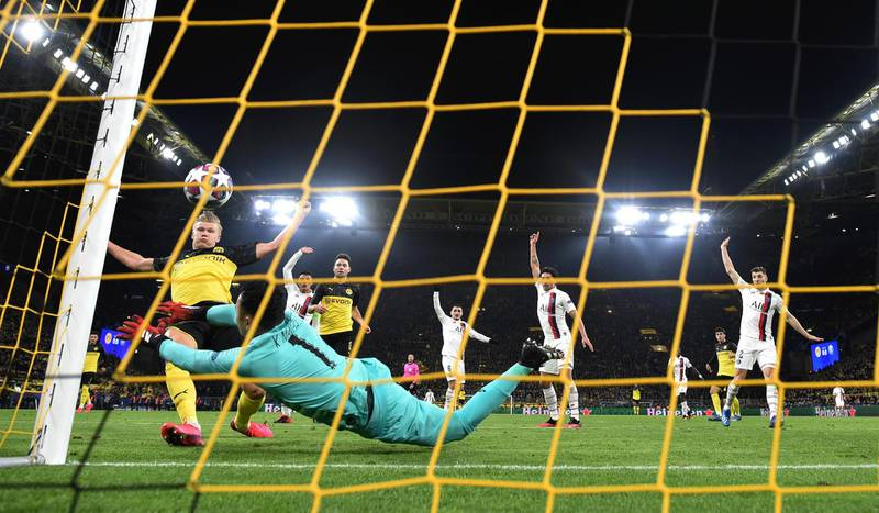 DORTMUND, GERMANY - FEBRUARY 18: Erling Haaland of Borussia Dortmund scores his team's first goal past Keylor Navas of Paris Saint-Germain during the UEFA Champions League round of 16 first leg match between Borussia Dortmund and Paris Saint-Germain at Signal Iduna Park on February 18, 2020 in Dortmund, Germany. (Photo by Stuart Franklin/Bongarts/Getty Images)