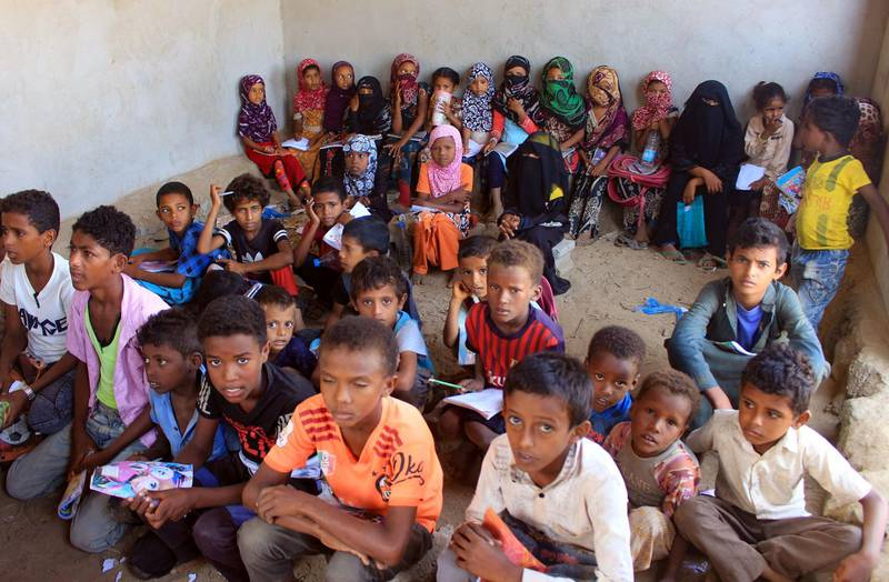 Displaced Yemeni children attend a class in a house turned into a school in the northern province, on November 4, 2020.  / AFP / ESSA AHMED
