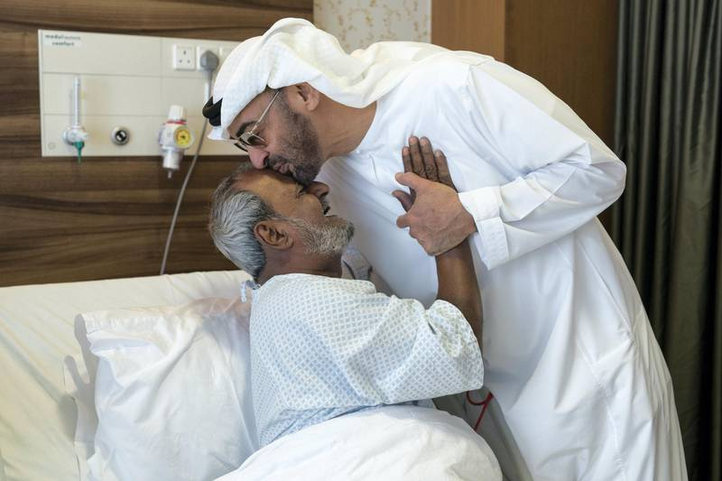 ABU DHABI, UNITED ARAB EMIRATES -  March 11, 2018: HH Sheikh Mohamed bin Zayed Al Nahyan, Crown Prince of Abu Dhabi and Deputy Supreme Commander of the UAE Armed Forces (2nd L), bids farewell to Fadel Mahmoud Saleh (L), who is in Abu Dhabi receiving medical assistance at Burjeel Hospital.  ( Ryan Carter for the Crown Prince Court - Abu Dhabi ) ---