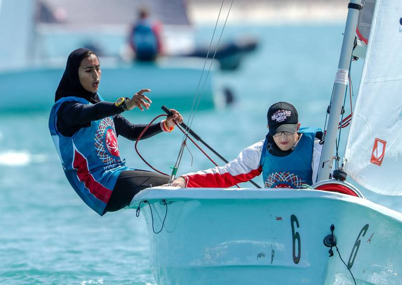 Abu Dhabi, March 20, 2019.  Special Olympics World Games Abu Dhabi 2019.  Sailing Level 1.--  Salama Al Mansoori instruct and Mark Meerberg during the race.Victor Besa/The National