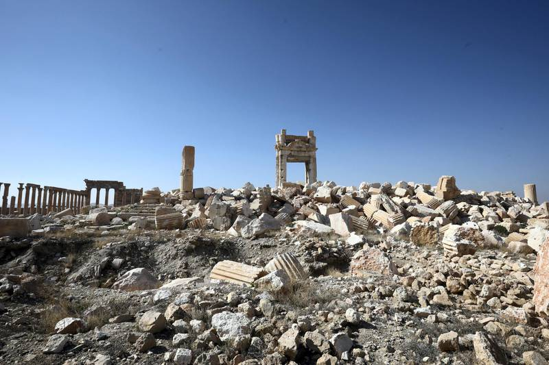 A picture shows a partial view of the damaged Temple of Bel, in Syria's Roman-era ancient city of Palmyra on February 7, 2021, in the country's central province of Homs. - Syria has six sites listed on the UNESCO elite list of world heritage and all of them sustained some level of damage in the 10-year war. Besides Palmyra and Aleppo, the ancient cities of Damascus and Bosra also sustained some damage. (Photo by LOUAI BESHARA / AFP)