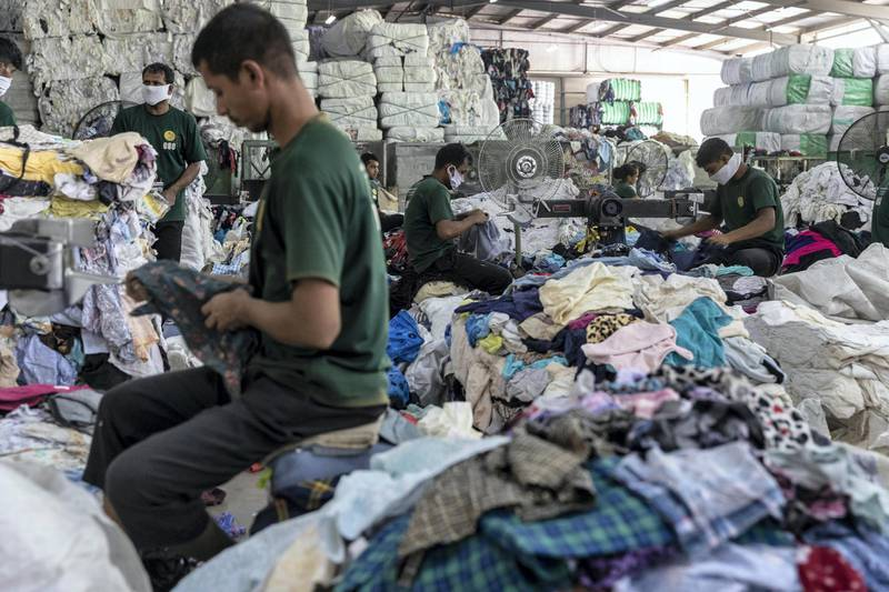 DUBAI, UNITED ARAB EMIRATES. 24 OCTOBER 2019. Second hand clothing from the UK, Australia and Europe is sported by type and quality at Hands Industries in Sharjah. Some clothes are destined to be re sold in third world markets in Africa while other damaged items are cut for use as rags in Industrial or commercial applications. (Photo: Antonie Robertson/The National) Journalist: Kelly Clarke. Section: National.