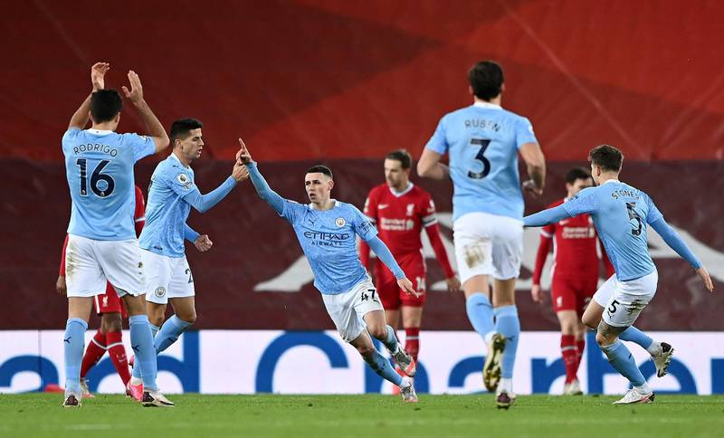 LIVERPOOL, ENGLAND - FEBRUARY 07: Phil Foden of Manchester City celebrates after scoring their side's fourth goal during the Premier League match between Liverpool and Manchester City at Anfield on February 07, 2021 in Liverpool, England. Sporting stadiums around the UK remain under strict restrictions due to the Coronavirus Pandemic as Government social distancing laws prohibit fans inside venues resulting in games being played behind closed doors. (Photo by Laurence Griffiths/Getty Images)