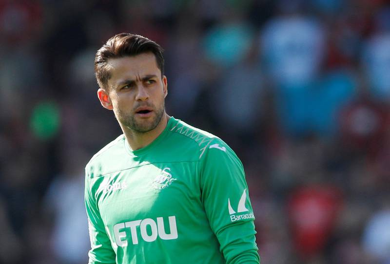 """Soccer Football - Premier League - AFC Bournemouth vs Swansea City - Vitality Stadium, Bournemouth, Britain - May 5, 2018   Swansea City's Lukasz Fabianski looks dejected after the match               REUTERS/David Klein    EDITORIAL USE ONLY. No use with unauthorized audio, video, data, fixture lists, club/league logos or """"live"""" services. Online in-match use limited to 75 images, no video emulation. No use in betting, games or single club/league/player publications.  Please contact your account representative for further details."""