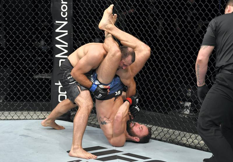 ABU DHABI, UNITED ARAB EMIRATES - JULY 26: (R-L) Paul Craig of Scotland attempts to secure a triangle choke against Gadzhimurad Antigulov of Russia in their light heavyweight fight during the UFC Fight Night event inside Flash Forum on UFC Fight Island on July 26, 2020 in Yas Island, Abu Dhabi, United Arab Emirates. (Photo by Jeff Bottari/Zuffa LLC via Getty Images)