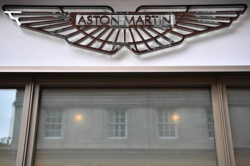 (FILES) In this file photo taken on August 29, 2018 Signage on the front of an Aston Martin showroom in central London on August 29, 2018.  The Racing Point Formula One team will be rebranded Aston Martin from 2021, James Bond's favourite carmaker said Friday after securing a large cash injection to get back on track. / AFP / BEN STANSALL