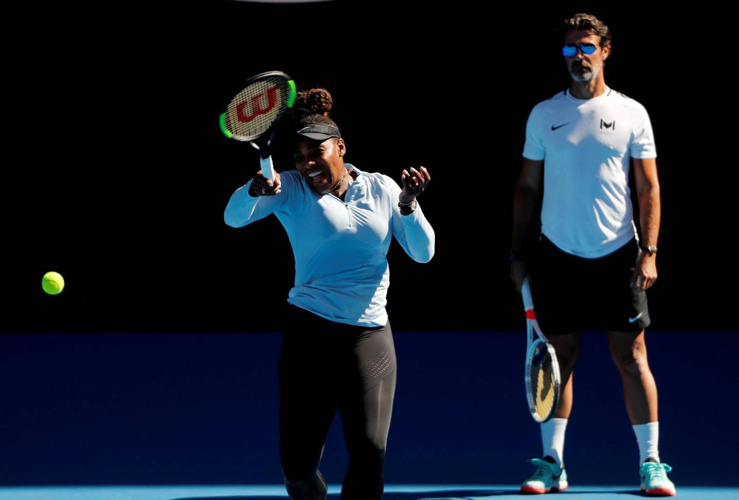 Tennis - Australian Open - Melbourne Park, Melbourne, Australia - January 13, 2019-Serena Williams of the U.S. and her coach Patrick Mouratoglou at a practice.   REUTERS/Kim Kyung-Hoon