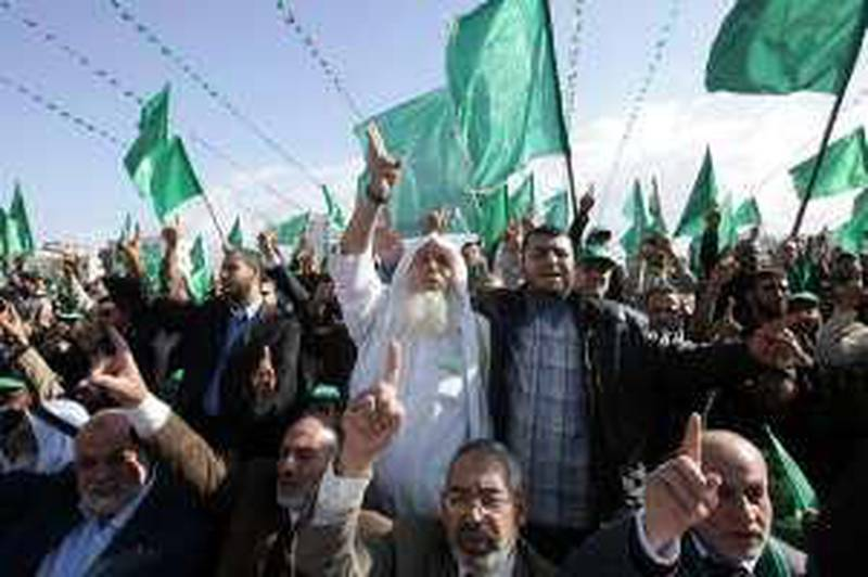 GAZA CITY, GAZA - DECEMBER 14:  Hamas supporters wave flags and shout slogans as they gather at a mass rally on December 14, 2008 in Gaza City, Gaza Strip. Hundreds of thousands attended the Hamas rally to mark the 21st anniversary of the founding of the militant group, Hamas. (Photo by Abid Katib/Getty Images)