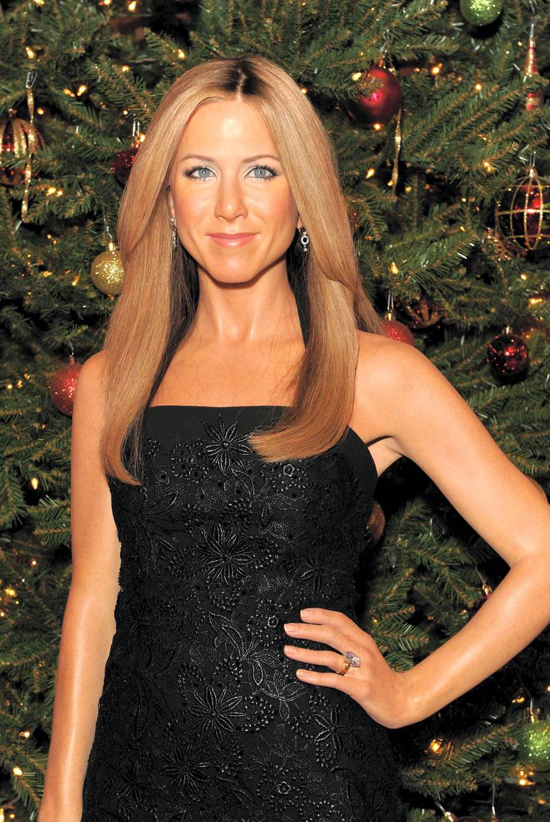 NEW YORK, NY - DECEMBER 13:  Jennifer Aniston warms up winter at Madame Tussausds New York at Madame Tussauds on December 13, 2012 in New York City.  (Photo by Craig Barritt/Getty Images for Madame Tussauds New York)