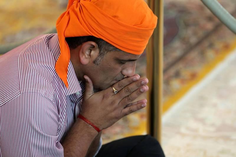 Dubai, United Arab Emirates - May 15, 2019: Members of the congregation pray. People take part in a multi faith Iftar at Gurunanak Darbar Sikh Gurudwara. Wednesday the 15th of May 2019. Jebel Ali, Dubai. Chris Whiteoak / The National