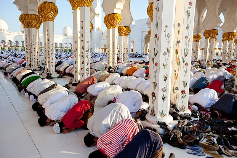 November 15, 2010 / Abu Dhabi / (Rich-Joseph Facun / The National) People gather at the Sheikh Zayed Grand Mosque for the Eid al-Adha Prayer, Tuesday, November 15, 2010 in Abu Dhabi. The Sheikh Zayed Grand Mosque is the largest mosque in the United Arab Emirates.
