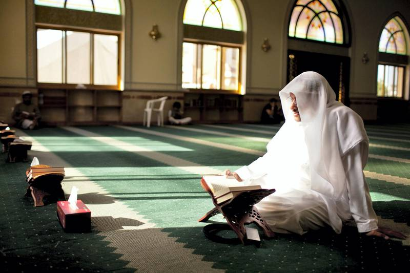 A man reads passages of Quran during his afternoon prayers at a mosque on the outskirts of  the Khalidiya neighborhood in Abu Dhabi on Tuesday evening, August 1, 2011, the first day of Ramadan. (Silvia Razgova/The National)
