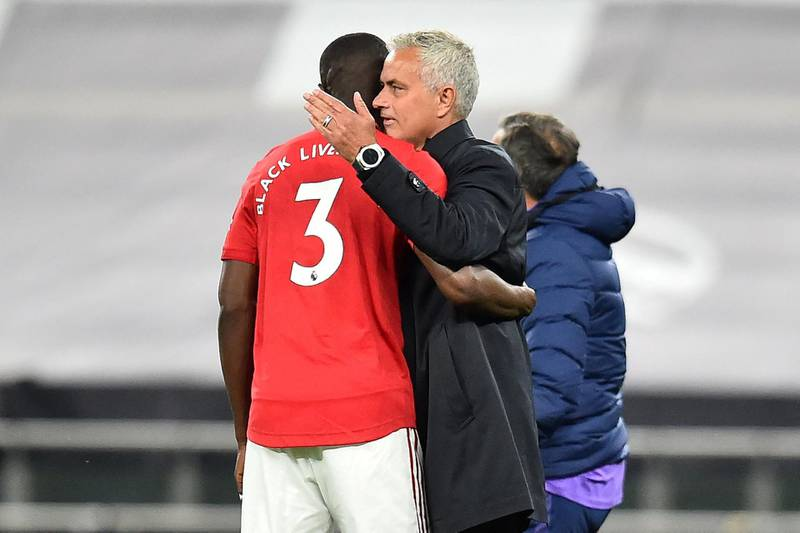 Tottenham Hotspur's Portuguese head coach Jose Mourinho (R) speaks with Manchester United's Ivorian defender Eric Bailly on the pitch after the English Premier League football match between Tottenham Hotspur and Manchester United at Tottenham Hotspur Stadium in London, on June 19, 2020. - The match ended 1-1. (Photo by Glyn KIRK / POOL / AFP) / RESTRICTED TO EDITORIAL USE. No use with unauthorized audio, video, data, fixture lists, club/league logos or 'live' services. Online in-match use limited to 120 images. An additional 40 images may be used in extra time. No video emulation. Social media in-match use limited to 120 images. An additional 40 images may be used in extra time. No use in betting publications, games or single club/league/player publications. /