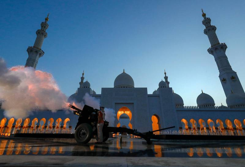 Abu Dhabi, United Arab Emirates, May 6, 2020.  A canon is fired at the Sheikh Zayed Grand Mosque to mark the beginning of iftar.Victor Besa / The NationalSection:  NAReporter: