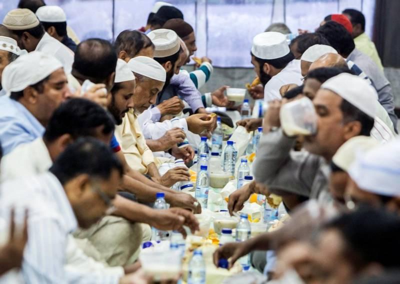 DUBAI,  UNITED ARAB EMIRATES, 20 May 2018 - Muslims during ftar at Lootah Masjid Mosque, Deira, Dubai. Leslie Pableo for The National  for Ramola Talwar story