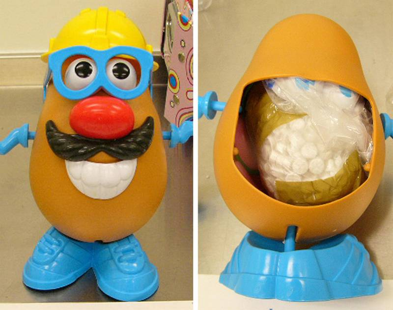 This combo of handouts made available by the Australian customs 04 October 2007, shows the popular children's toy Mr Potato Head, from the front (L), and a view from the rear in which ecstacy tablets were hidden, that was seized by Customs officers at the Sydney International Mail Centre. Customs officals said that they had discovered a large amount of ecstasy inside the Mr Potato Head mailed to Sydney from Ireland. When a panel from the toy's back was removed, a quantity of MDMA (ecstasy) tablets weighing an estimated 293 grams (10.3 ounces) was found in a small taped bag concealed in the cavity space.   AFP PHOTO / Australian Customs / HO (Photo by AFP / AUSTRALIAN CUSTOMS / AFP)