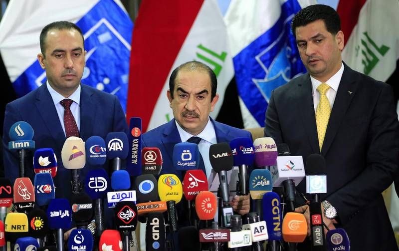epa06748419 Riyadh Al-Badran (C), the head of Iraq's Independent Higher Election Commission, attends a press conference with members of the Commission to announce the official results of parliamentary election in Baghdad, Iraq, 19 May 2018. Iraqi electoral commission said, that the Sa'airon coalition of Iraqi Shiite cleric and head of Sadr movement Muqtada al-Sadr, has won the first place in the voting and got 54 seats in Iraq's parliamentary elections.  EPA/ALI ABBAS