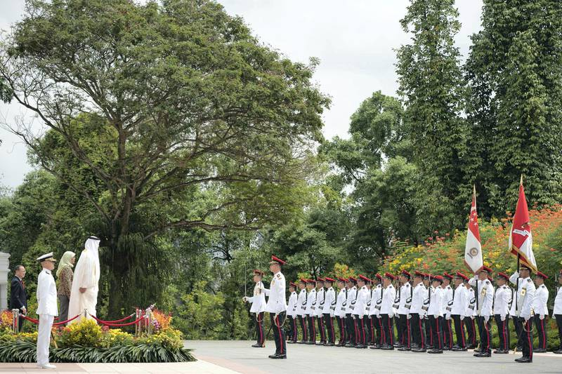 SINGAPORE, SINGAPORE - February 28, 2019: HH Sheikh Mohamed bin Zayed Al Nahyan, Crown Prince of Abu Dhabi and Deputy Supreme Commander of the UAE Armed Forces (4th L), stands for the national anthem with HE Halimah Yacob, President of Singapore (back 3rd L), during a reception at the Istana presidential palace. ( Ryan Carter / Ministry of Presidential Affairs )