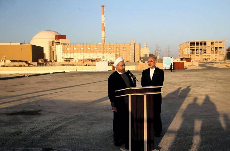 """A handout picture released by the official website of the Iranian President Hassan Rouhani, shows him (L) and Iran's Atomic Energy Organisation chief Ali Akbar Salehi addressing journalists at the Bushehr nuclear power plant in the Gulf port city of Bushehr on January 13, 2015. Rouhani implicitly warned US lawmakers against adopting any new sanctions linked to Iran's controversial nuclear programme, saying they would fail as his country was beginning to exit the sanctions-era. AFP PHOTO / IRANIAN PRESIDENCY WEBSITE / MOHAMMAD BERNO  == RESTRICTED TO EDITORIAL USE - MANDATORY CREDIT """"AFP PHOTO / IRANIAN PRESIDENCY WEBSITE / MOHAMMAD BERNO """" - NO MARKETING NO ADVERTISING CAMPAIGNS - DISTRIBUTED AS A SERVICE TO CLIENTS == (Photo by MOHAMMAD BERNO / IRANIAN PRESIDENCY / AFP)"""