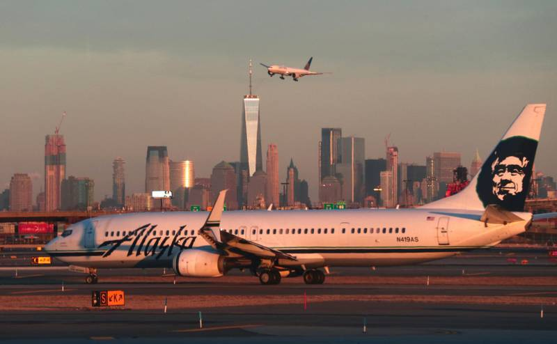 NEWARK, NJ - JANUARY 21: An Alaska Airlines airplane passes by the skyline of lower Manhattan in New York City as it heads to a gate at Newark Liberty Airport on January 21, 2019 in Newark, New Jersey. (Photo by Gary Hershorn/Getty Images)